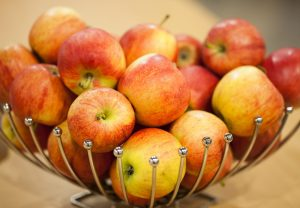Charming arrangement of apples in a metal basket