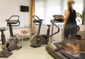 The fitness studio has a treadmill, two exercise bikes and a crosstrainer