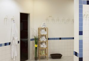 The sauna decorated with white and blue tiles – sauna towels to change into are provided in the sauna itself