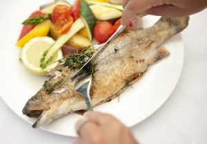 Delicately grilled trout with vegetables, potatoes and herbs