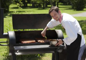 Our chef putting some ribs on the barbecue – here he's applying the marinade