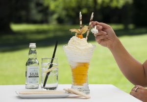Delicious ice-cream with mango sorbet, lemon sorbet, coconut milk, pineapple syrup, whipped cream, coconut flakes and Cointreau