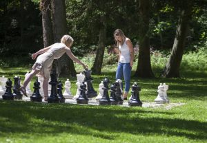 Guests play a game of chess on the park's concrete chessboard with giant chess pieces, each around 1 metre tall