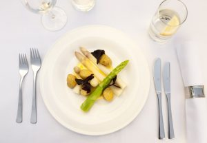 Green and white asparagus with roast potatoes and hollandaise sauce